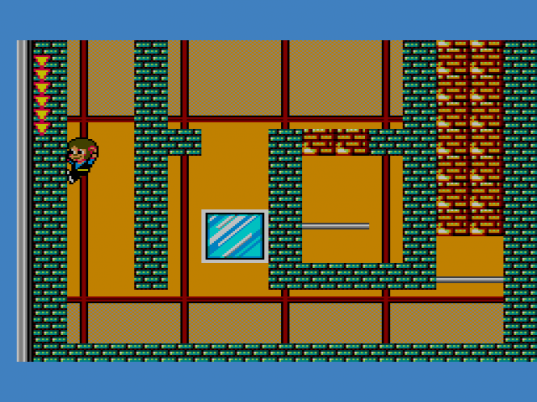 Alex Kidd jumping off a wall